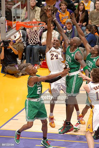 Kobe Bryant of the Los Angeles Lakers has his shot challenged by Kevin Garnett of the Boston Celtics at Staples Center on December 25 2008 in Los...
