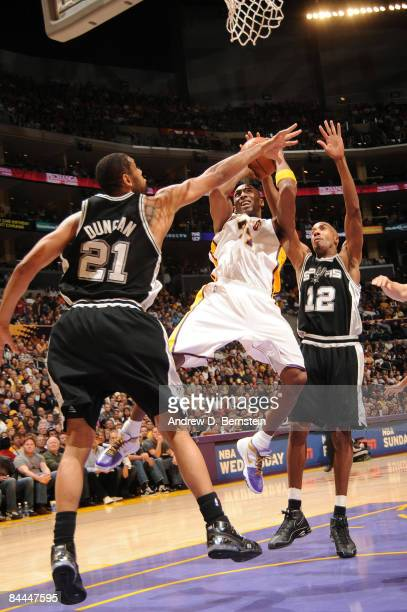 Kobe Bryant of the Los Angeles Lakers has his shot challenged by Tim Duncan and Bruce Bowen of the San Antonio Spurs at Staples Center on January 25...