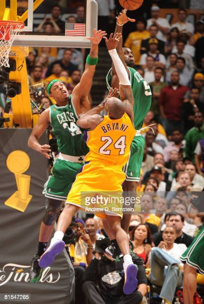 Kobe Bryant of the Los Angeles Lakers has his shot contested by Paul Pierce and Kevin Garnett of the Boston Celtics in Game Four of the 2008 NBA...