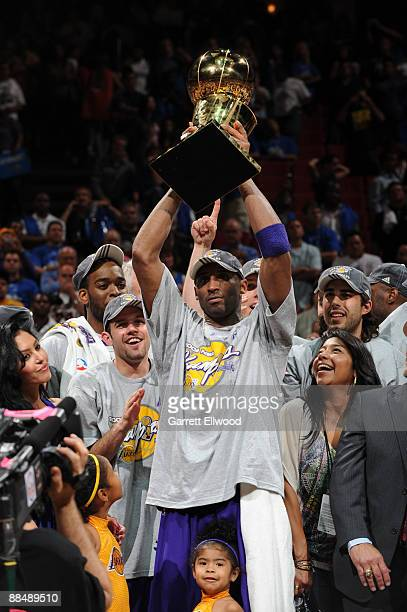 Kobe Bryant of the Los Angeles Lakers hoists the Larry O'Brien trophy after defeating the Orlando Magic in Game Five of the 2009 NBA Finals at Amway...