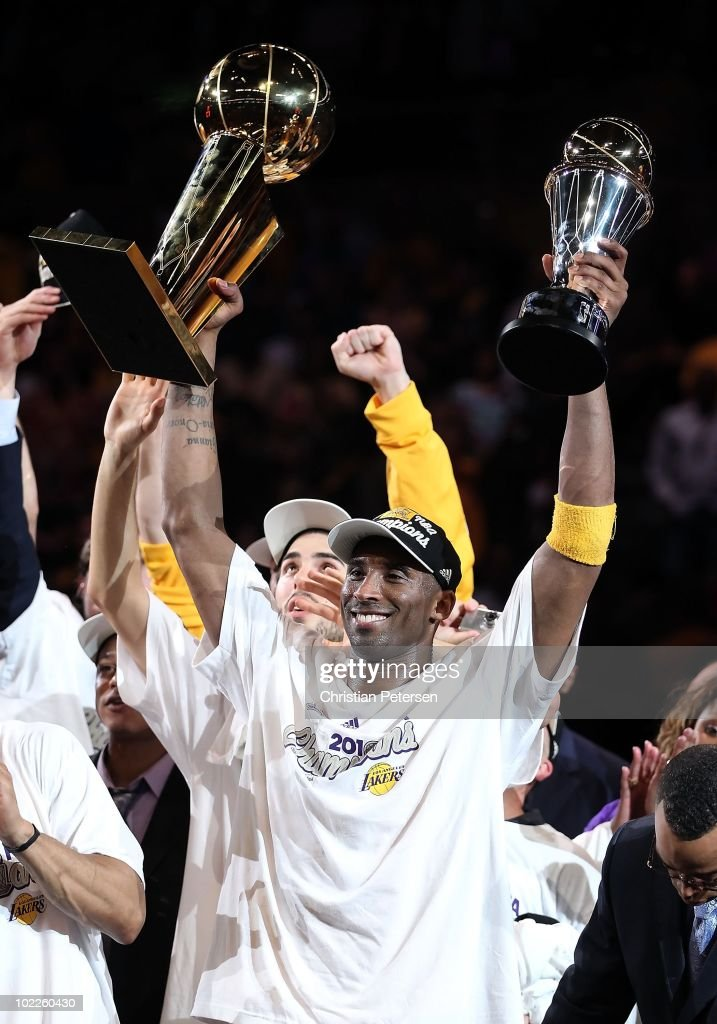 Kobe Bryant #24 of the Los Angeles Lakers holds both the Larry O'Brien trophy and the Bill Russell Finals MVP trophy after the Lakers defeated the Boston Celtics 83-79 in Game Seven of the 2010 NBA Finals at Staples Center on June 17, 2010 in Los Angeles, California.
