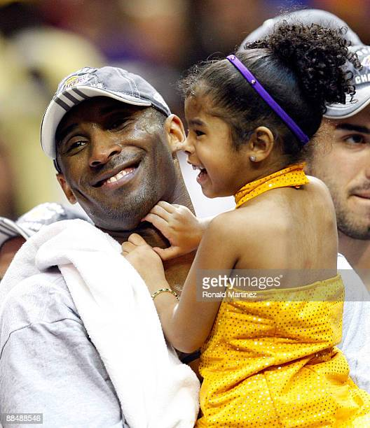 Kobe Bryant of the Los Angeles Lakers holds his daughter Gianna after the Lakers defeated the Orlando Magic 9986 in Game Five of the 2009 NBA Finals...
