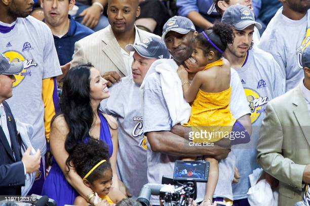 Kobe Bryant of the Los Angeles Lakers holds his daughter Gianna Bryant next to her mother Vanessa Bryant after Game Five of the 2009 NBA Finals...