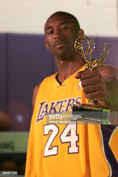 Kobe Bryant of the Los Angeles Lakers holds up a miniature Emmy Award statue during NBA Media Day on September 29 2008 at the Toyota Sports Center in...
