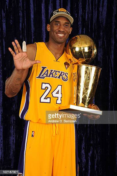 Kobe Bryant of the Los Angeles Lakers holds up five fingers for a portrait following his team's victory over the Boston Celticsin Game Seven of the...