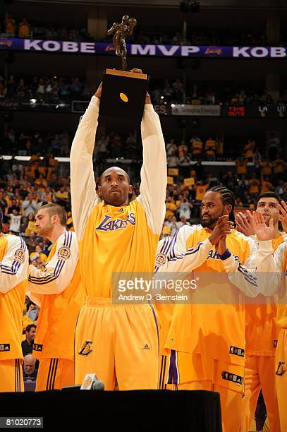 Kobe Bryant of the Los Angeles Lakers holds up the 200708 NBA Most Valuable Player award prior to taking on the Utah Jazz in Game Two of the Western...