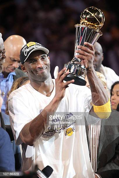 Kobe Bryant of the Los Angeles Lakers holds up the Bill Russell Finals MVP trophy after the Lakers defeated the Boston Celtics 83-79 in Game Seven of...