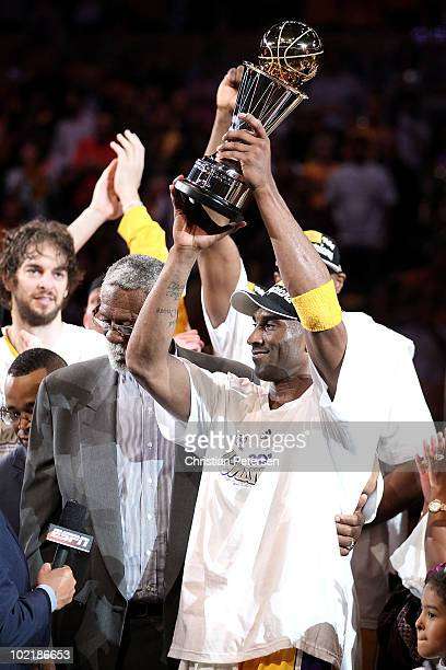 Kobe Bryant of the Los Angeles Lakers holds up the Bill Russell Finals MVP trophy after the Lakers defeated the Boston Celtics in Game Seven of the...