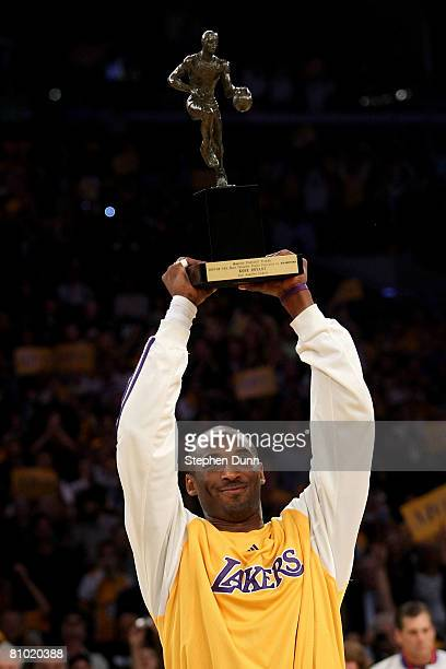Kobe Bryant of the Los Angeles Lakers holds up the MVP Trophy before the start of Game Two of the Western Conference Semifinals against the Utah Jazz...