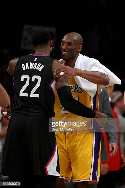 Kobe Bryant of the Los Angeles Lakers hugs Branden Dawson of the Los Angeles Clippers after an NBA game between the Los Angeles Clippers and Los...