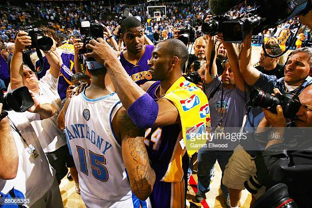 Kobe Bryant of the Los Angeles Lakers hugs Carmelo Anthony of the Denver Nuggets after Game Six of the Western Conference Finals during the 2009 NBA...