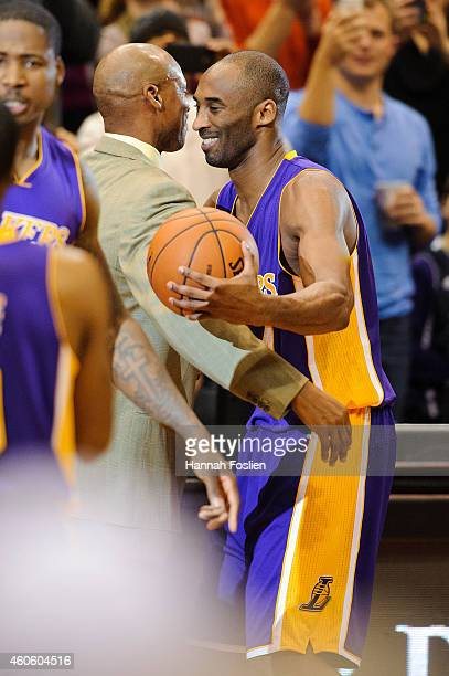 Kobe Bryant of the Los Angeles Lakers hugs head coach Byron Scott after passing Michael Jordan on the alltime scoring list with a free throw in the...