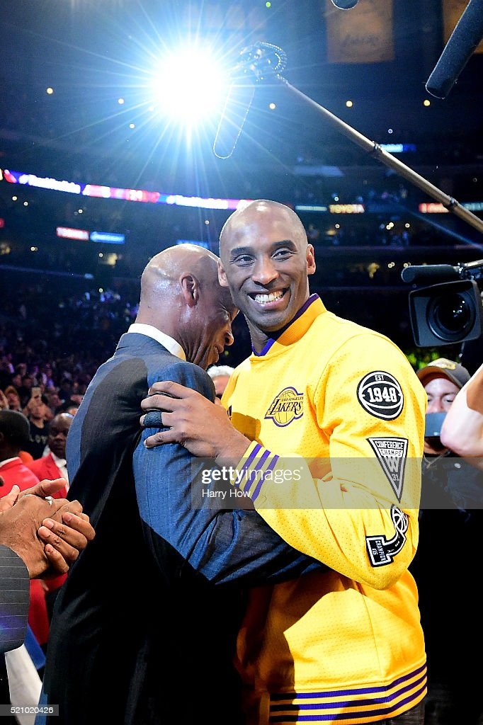 Kobe Bryant #24 of the Los Angeles Lakers hugs head coach Byron Scott before taking on the Utah Jazz in Bryant's final NBA game at Staples Center on April 13, 2016 in Los Angeles, California.
