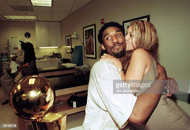 Kobe Bryant of the Los Angeles Lakers hugs his fiance Vanessa Lang while in the locker room after defeating the Indiana Pacers in Game 6 of the 2000...