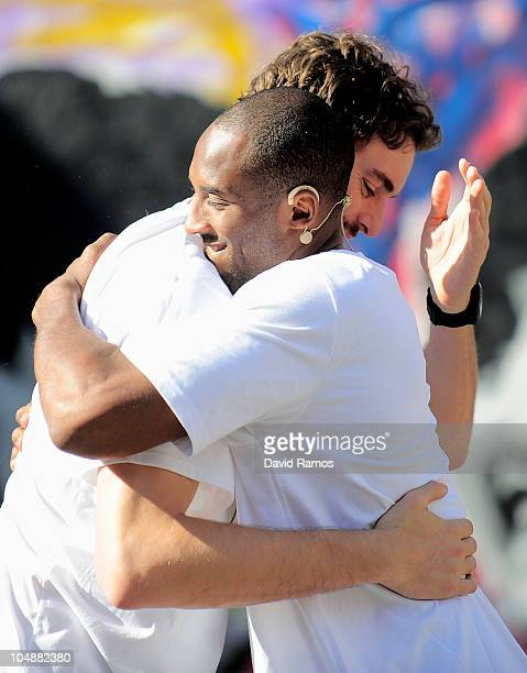 Kobe Bryant of the Los Angeles Lakers hugs his teammate Pau Gasol during the 'House of Hoops' contest by Foot Locker on October 6 2010 in Barcelona...