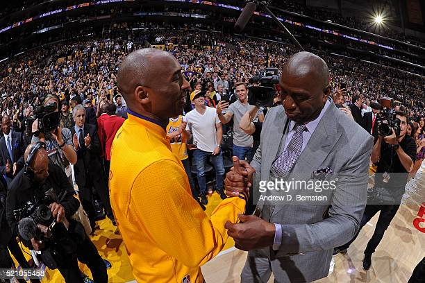 Kobe Bryant of the Los Angeles Lakers hugs NBA Legend Magic Johnson after he introduces him before his last game against the Utah Jazz on April 13...