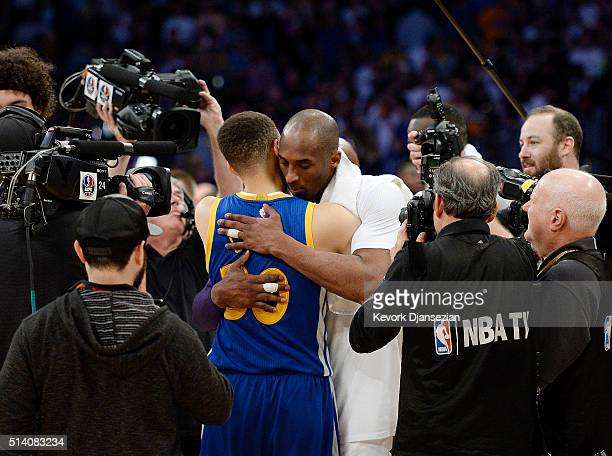 Kobe Bryant of the Los Angeles Lakers hugs Stephen Curry of the Golden State Warriors at the end of the basketball game at Staples Center March 6 in...