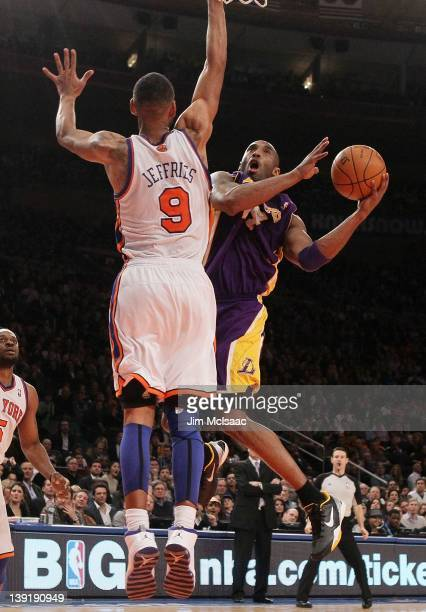 Kobe Bryant of the Los Angeles Lakers in action against Jared Jeffries of the New York Knicks on February 10 2012 at Madison Square Garden in New...
