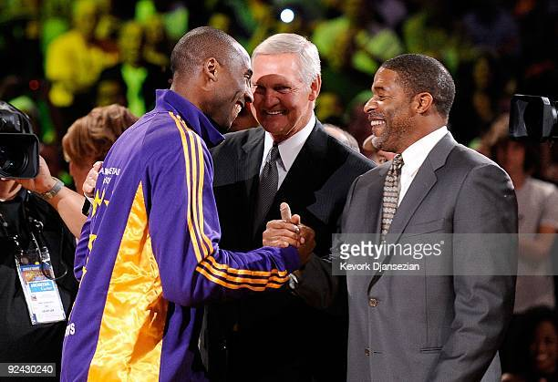 Kobe Bryant of the Los Angeles Lakers is congratulated by former Laker champions Jerry West and Norm Nixon after receiving his 2009 NBA Championship...