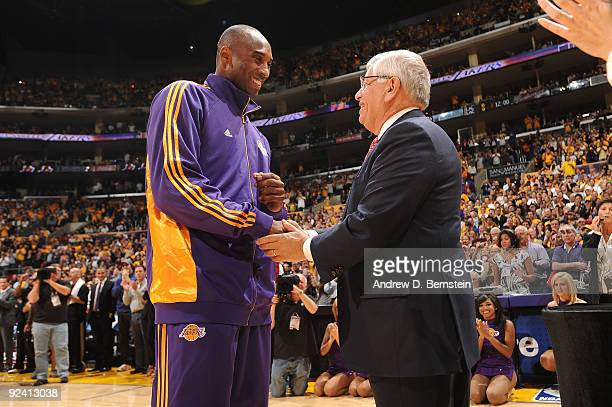 Kobe Bryant of the Los Angeles Lakers is congratulated by NBA Commissioner David Stern during the 2009 NBA Championship ring ceremony before the...
