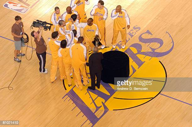 Kobe Bryant of the Los Angeles Lakers is congratulated by teammates after receiving the 200708 NBA Most Valuable Player Award before taking on the...