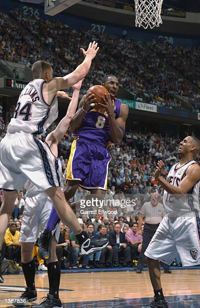 Kobe Bryant of the Los Angeles Lakers is defended by Aaron Williams of the New Jersey Nets during Game four of the 2002 NBA Finals on June 12, 2002...