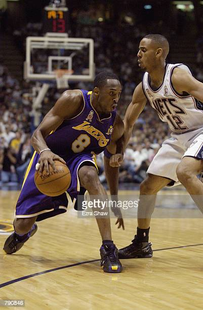 Kobe Bryant of the Los Angeles Lakers is defended by Lucious Harris of the New Jersey Nets in Game four of the 2002 NBA Finals at Continental...