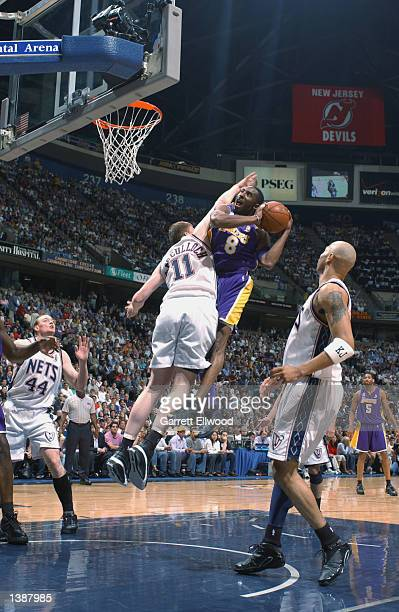 Kobe Bryant of the Los Angeles Lakers is defended by Todd MacCulloch of the New Jersey Nets during Game four of the 2002 NBA Finals on June 12 2002...