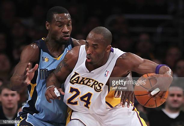 Kobe Bryant of the Los Angeles Lakers is defended by Tony Allen of the Memphis Grizzlies during the first half at Staples Center on January 2 2011 in...