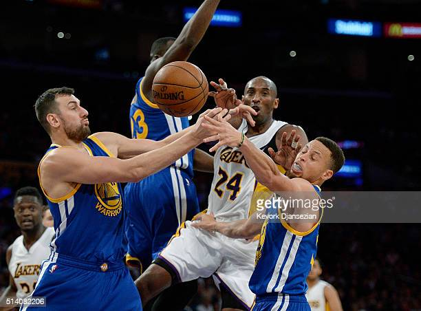 Kobe Bryant of the Los Angeles Lakers is double teamed by Stephen Curry and Andrew Bogut of the Golden State Warriors during the second half of the...