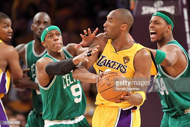 Kobe Bryant of the Los Angeles Lakers is doubleteammed by Rajon Rondo and Paul Pierce of the Boston Celtics in the third quarter of Game Seven of the...