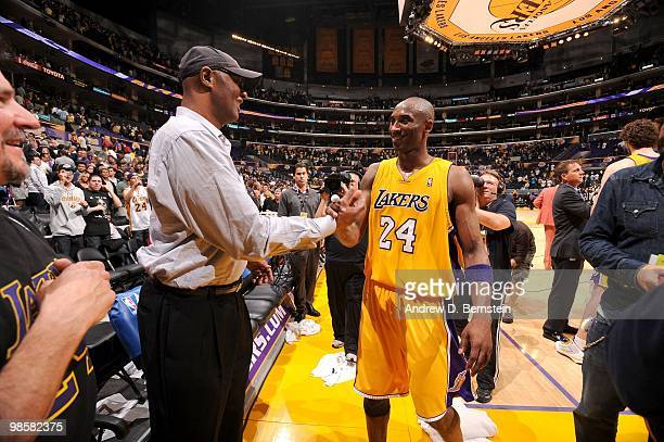 Kobe Bryant of the Los Angeles Lakers is greeted by his father Joe following his team's victory over the Oklahoma City Thunder in Game Two of the...