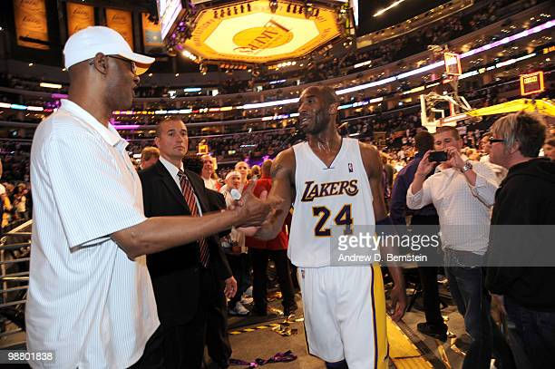 Kobe Bryant of the Los Angeles Lakers is greeted by his father, Joe, following his team's victory over the Utah Jazz in Game One of the Western...