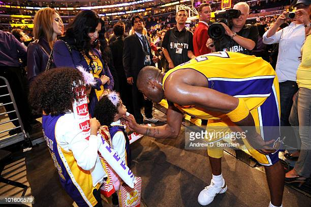 Kobe Bryant of the Los Angeles Lakers is greeted by his wife Vanessa and their daughters Natalia and Gianna following a win over the Boston Celtics...