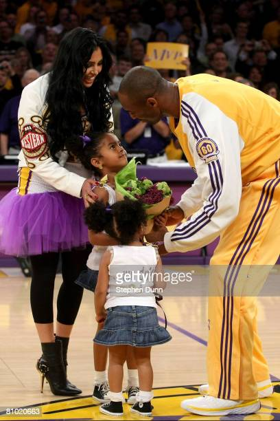 Kobe Bryant of the Los Angeles Lakers is greeted by his wife Vanessa and daughters Natalia and Gianna after receiving the MVP trophy before the start...
