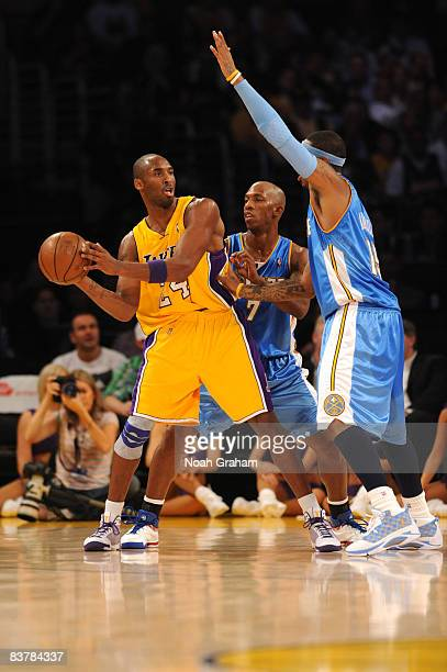 Kobe Bryant of the Los Angeles Lakers is guarded by Chauncey Billups and Carmelo Anthony of the Denver Nuggets at Staples Center on November 21 2008...