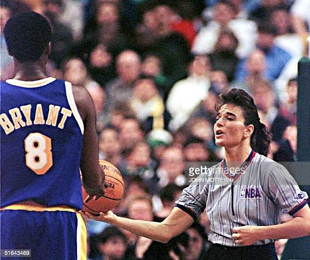 Kobe Bryant of the Los Angeles Lakers is handed the ball by NBA referee Dee Kantner the first female to ever referee a Boston Celtics game for a foul...