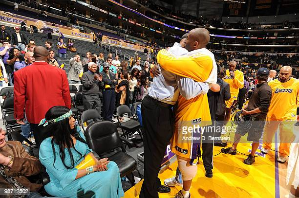 Kobe Bryant of the Los Angeles Lakers is hugged by his father Joe following his team's victory over the Oklahoma City Thunder in Game Five of the...