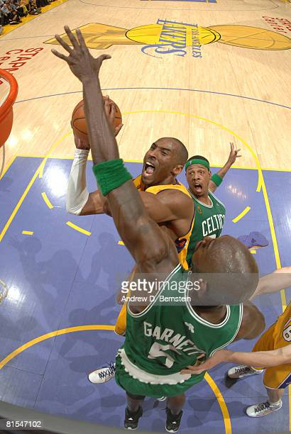 Kobe Bryant of the Los Angeles Lakers is met at the basket by Kevin Garnett of the Boston Celtics in Game Four of the 2008 NBA Finals at Staples...