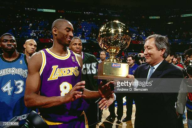 Kobe Bryant of the Los Angeles Lakers is presented with his trophy after winning the 1997 Nestle Crunch Slam Dunk Contest on February 8, 1997 at the...