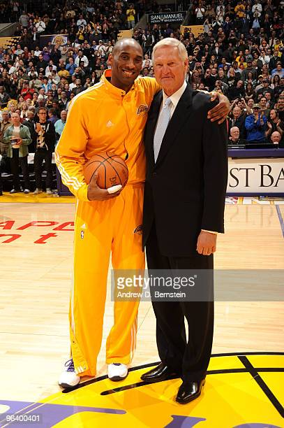 Kobe Bryant of the Los Angeles Lakers is presented with the game ball by former Laker Jerry West before a game against the Charlotte Bobcats at...