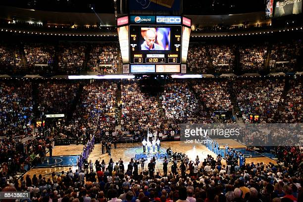 Kobe Bryant of the Los Angeles Lakers is seen on the Amway Arena scoreboard screen as he listens to the National Anthem prior to playing against the...