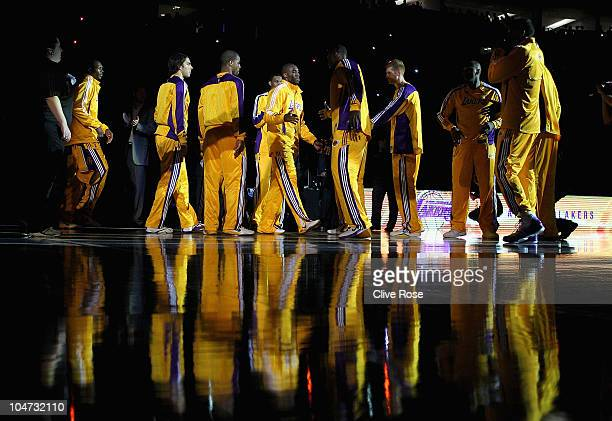 Kobe Bryant of the Los Angeles Lakers is welcomed onto the court by teammates ahead of the NBA Europe Live match between the Los Angeles Lakers and...