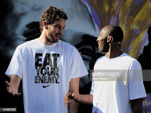 Kobe Bryant of the Los Angeles Lakers jokes with his teammate Pau Gasol during the 'House of Hoops' contest by Foot Locker on October 6, 2010 in...