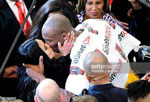 Kobe Bryant of the Los Angeles Lakers kises his wife Vanessa following Bryant's final game as a Laker in their seasonending NBA western division...
