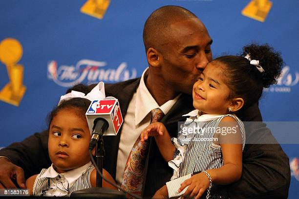 Kobe Bryant of the Los Angeles Lakers kisses daughter Gianna in a press conference after the Lakers' win over the Boston Celtics in Game Five of the...