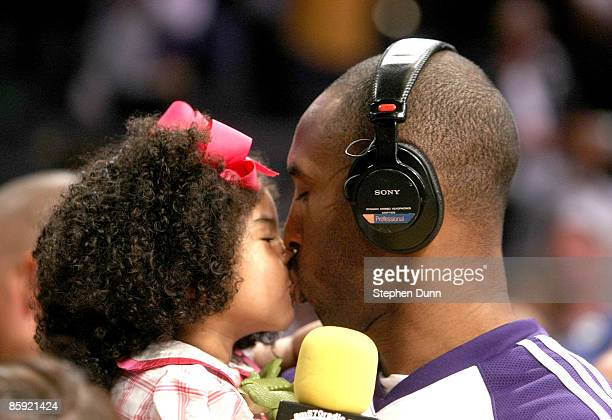 Kobe Bryant of the Los Angeles Lakers kisses daughter Gianna following the game with the Memphis Grizzlies on April 12, 2009 at Staples Center in Los...