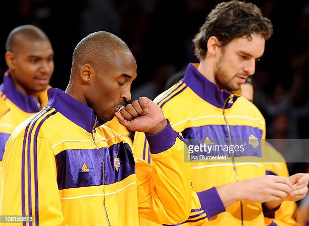 Kobe Bryant of the Los Angeles Lakers kisses his 20092010 Championship Ring during a ceremony prior to their opening night game against the Houston...