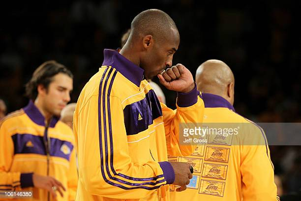 Kobe Bryant of the Los Angeles Lakers kisses his 20092010 Championship Ring after the Lakers were given the rings during a ceremony prior to their...