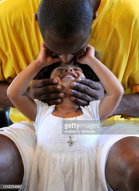 Kobe Bryant of the Los Angeles Lakers kisses his daughter Gianna Bryant during a photo session on March 29, 2008 at his home in Newport Beach,...